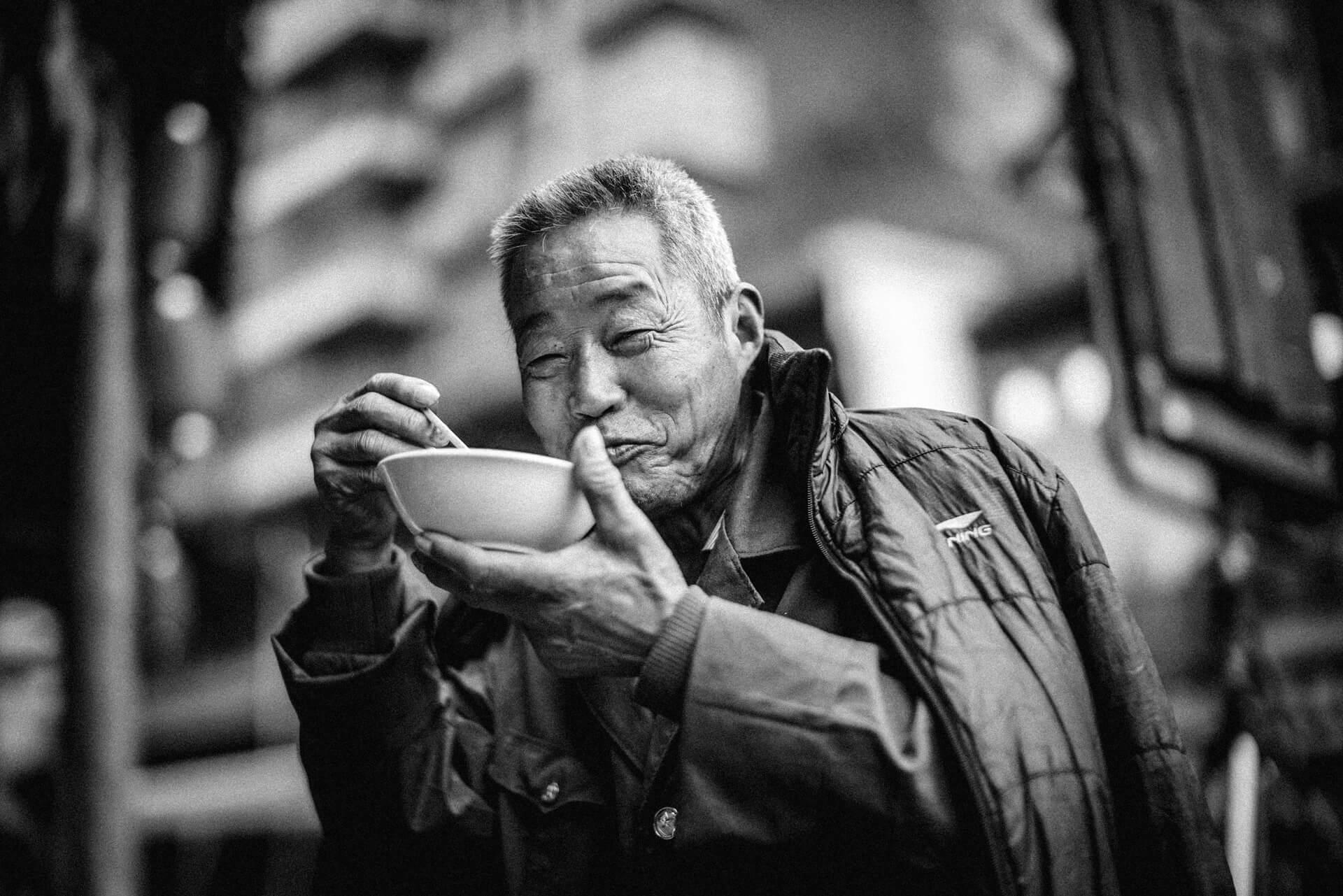 old-man-eating-on-bowl-3483771